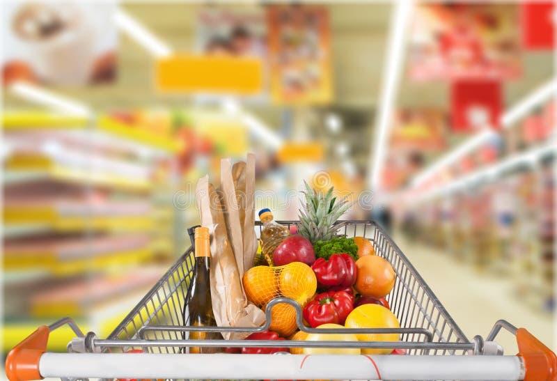 Shopping Cart. Supermarket Shopping Groceries Shelf Store Aisle royalty free stock photos