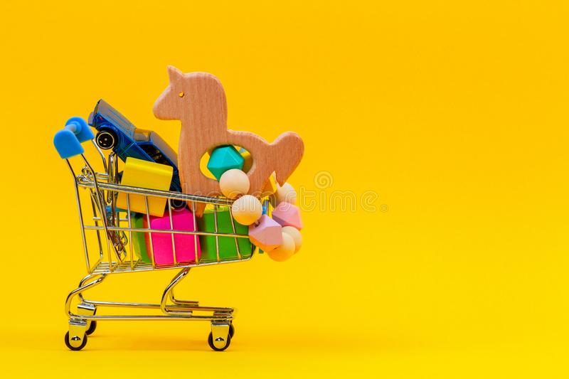 Shopping cart or supermarket trolley full of colorful numbers on yellow background. Shopping cart or supermarket trolley full of numbers on yellow background stock photography