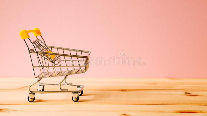 Shopping cart on table stock photo