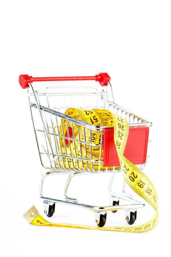 Shopping cart and tape measure stock photos