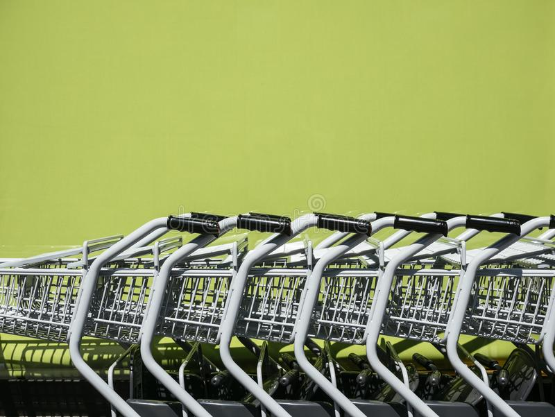 Shopping Cart Trolley in row Retail department store Consumer bu. Siness royalty free stock images