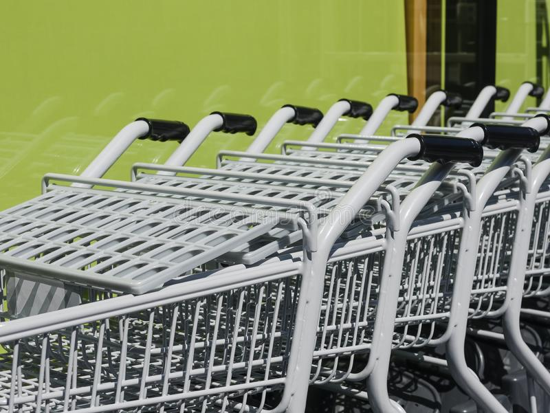 Shopping Cart Trolley in row Retail Consumer buyer. Shopping Cart Trolley in row Retail department store Consumer business royalty free stock photo