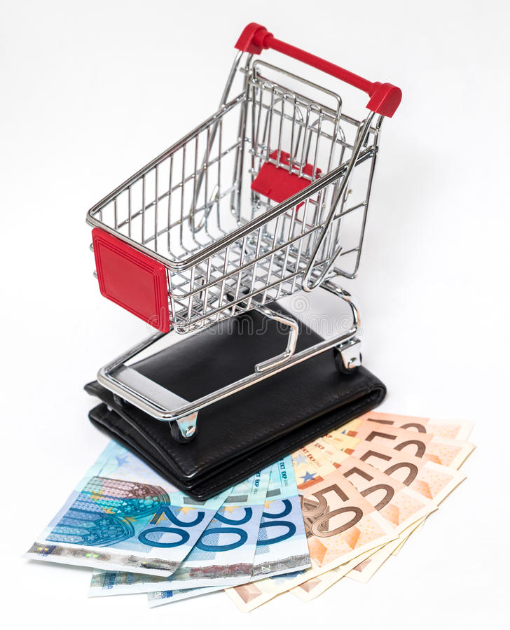 Shopping cart and wallet isolated. Shopping cart with black wallet and money isolated on white royalty free stock image