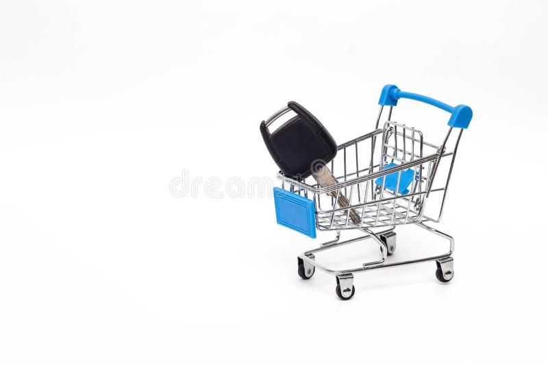 Shopping cart in which the key to the car, buying a car, business stock photos