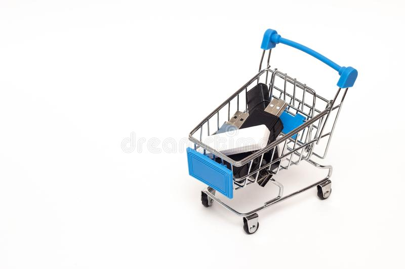 Shopping cart in which you can find flash drives with information, purchase information, copy space stock photo