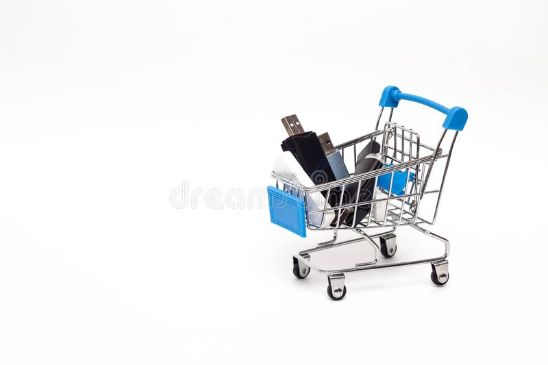 Shopping cart in which you can find flash drives with information, purchase information, copy space royalty free stock photo