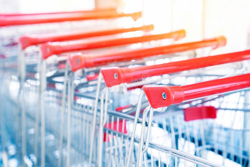 Shopping carts, Shopping cart trolley in row retail department store, Consumer business concept, Selective focus.  stock photography