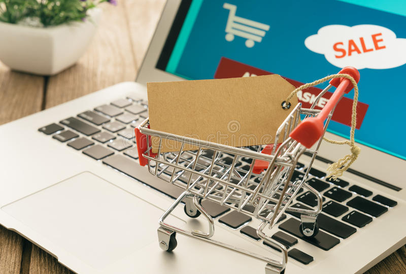 Shopping carts on a laptop. stock image