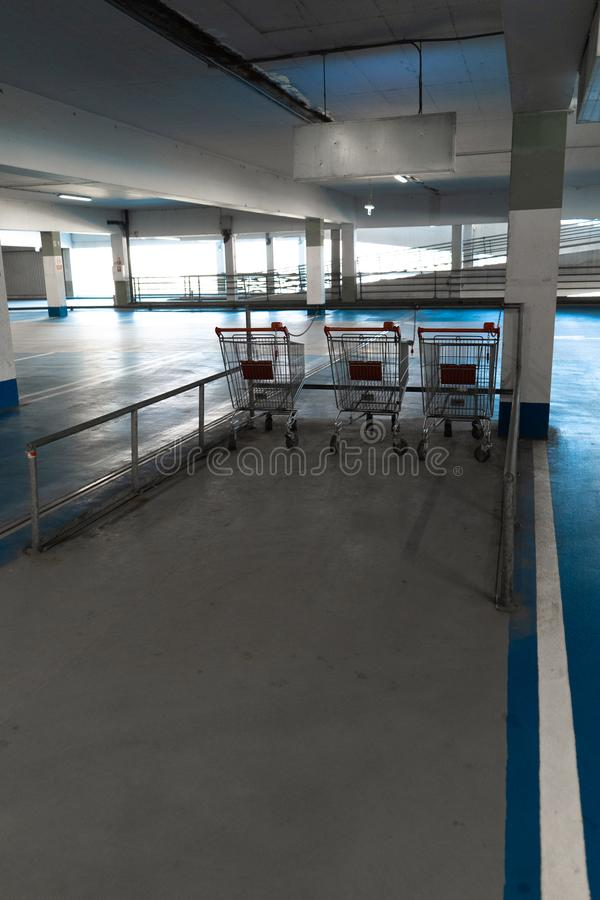 Shopping carts to take - Free vacant parking lot space in a Shopping centre multi story car park. Free vacant parking lot space in a Shopping centre multi story royalty free stock photos