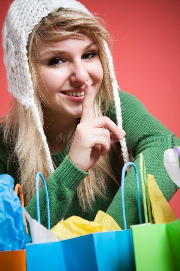 Shopping caucasian girl shushing stock photos