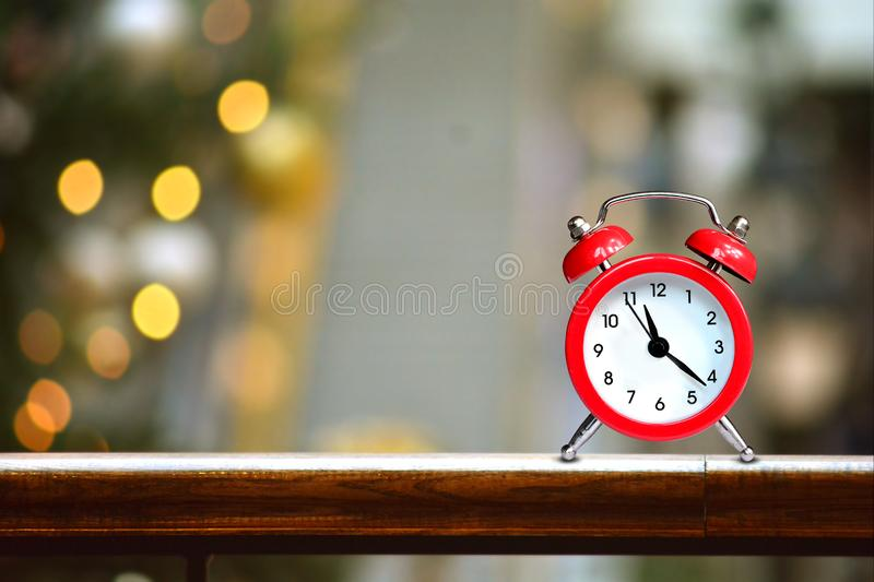 Shopping center mall blurred background with red alarm clock stock image