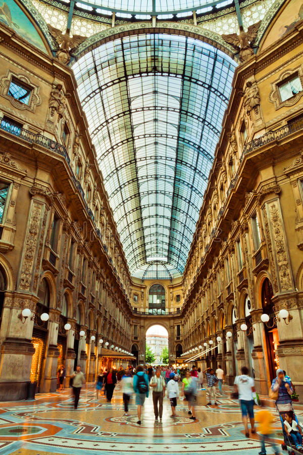 Shopping Centre in Milan. Inside the shopping mall Galleria Vittorio Emmanuele II - the first ever shopping centre and its amazing glass roof architecture. A lot royalty free stock photo