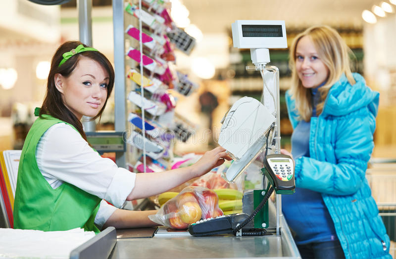 Shopping. Check out in supermarket store royalty free stock image