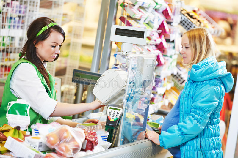 Shopping. Check out in supermarket store royalty free stock photo