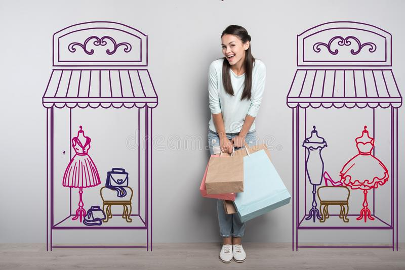 Happy student feeling excited while going shopping stock photography