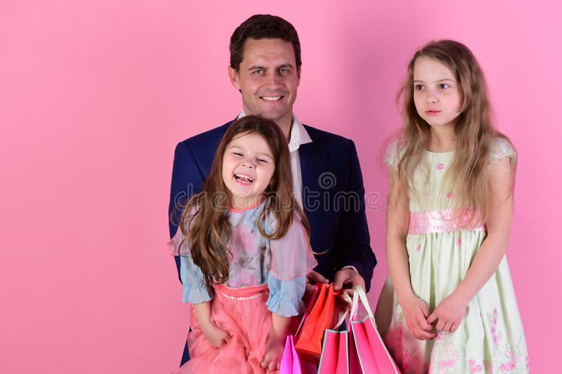 Shopping and family concept. Girls and man with happy faces royalty free stock photo