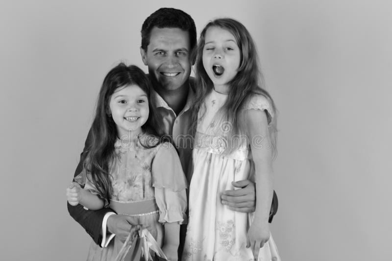 Shopping, childhood and family concept. Schoolgirls and dad stock image