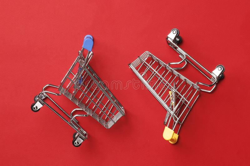 Wo shopping carts on a red background. Shopping concept. Two shopping carts on a red background, market royalty free stock photos