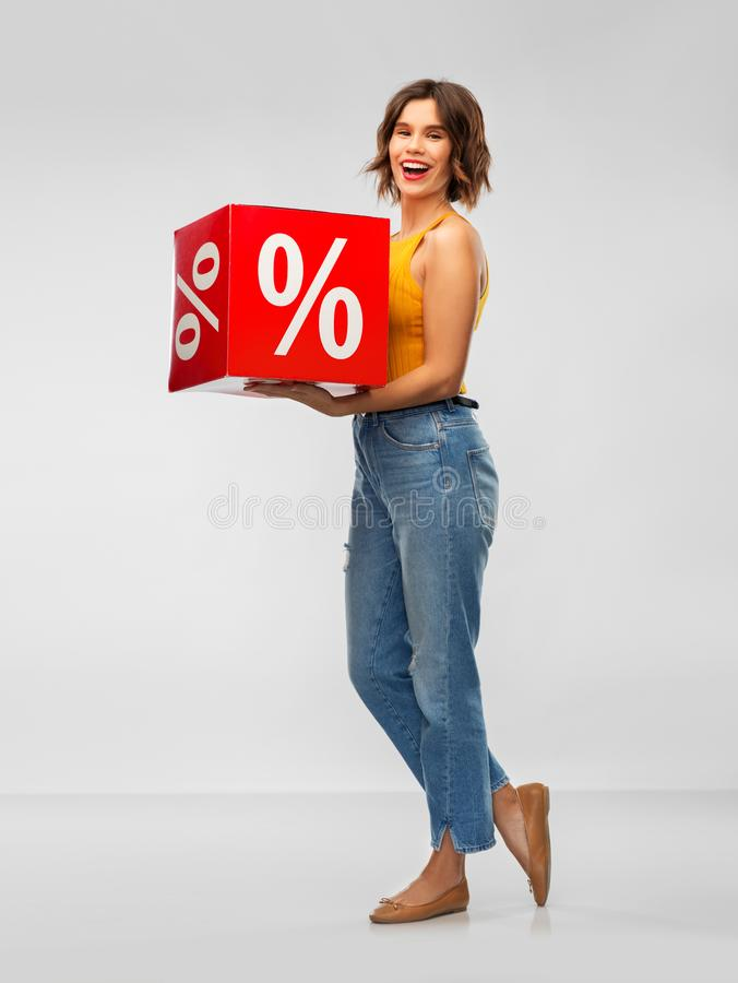 Happy smiling young woman with sale sign royalty free stock photos