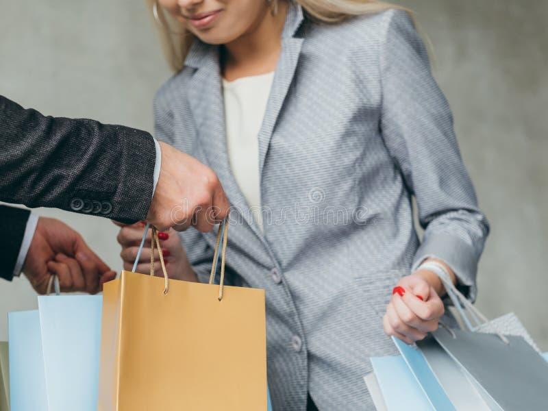 Shopping consumerism woman curious man bags stock photo