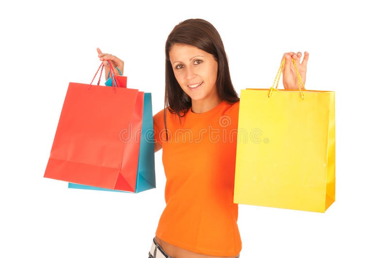 Shopping - Cute young girl with shopping bags stock photo