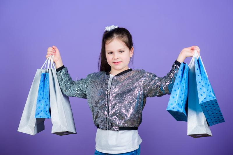 Shopping day. Child hold bunch packages. Kids fashion. Surprise gift. Great stores. Great choices. Girl with shopping stock photography