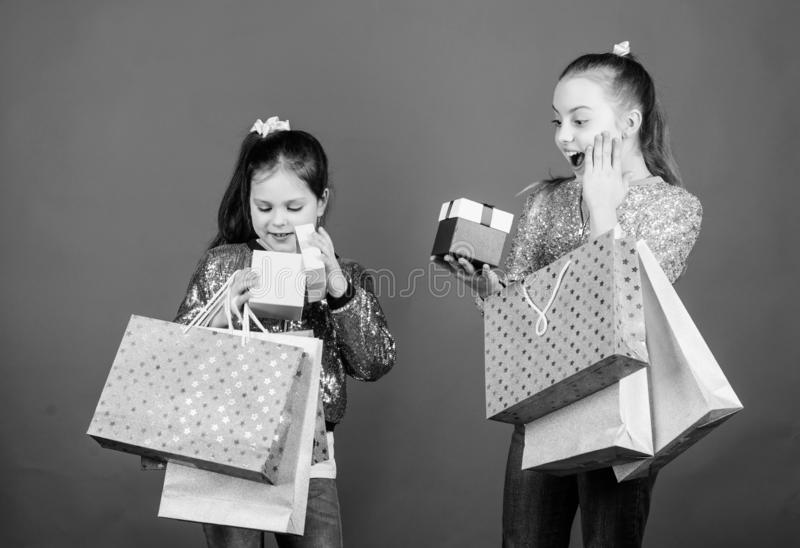 Shopping day. Children bunch packages. Kids fashion. Girls sisters friends with shopping bags blue background. Every royalty free stock photo