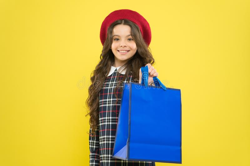 Shopping day. Happy child hold packages. Girl with shopping bag. Save money. Rediscover great shopping tradition royalty free stock images