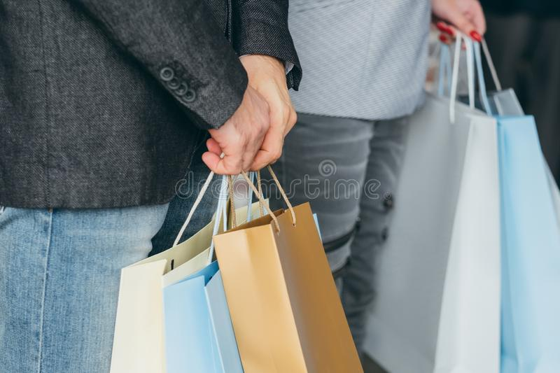 Shopping discounts couple multiple bags hands royalty free stock photos