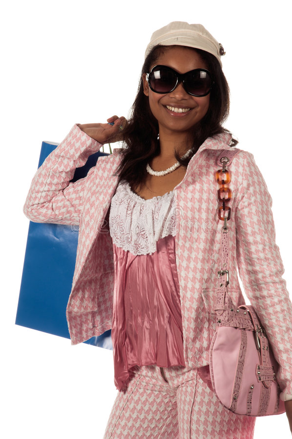 Shopping Diva. Young African American woman Holding colorful shopping bags stock photos