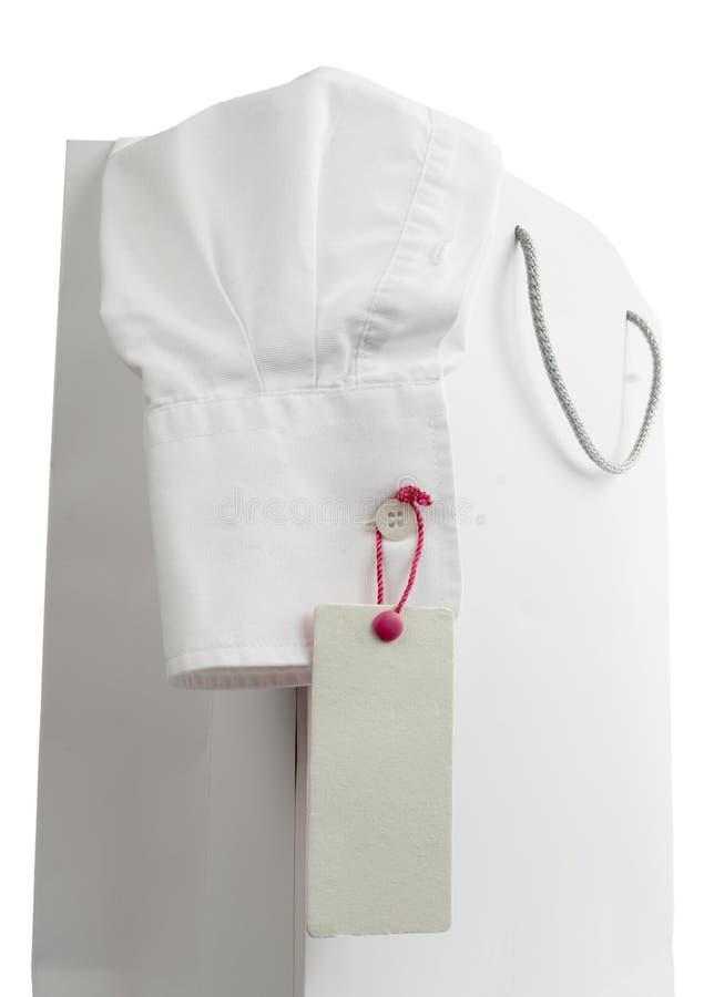 shopping för skjorta för påseetikettpris arkivbild