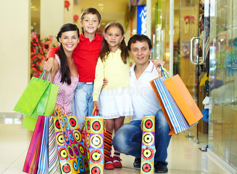 Download Shopping family stock image. Image of four, father, looking - 22852527