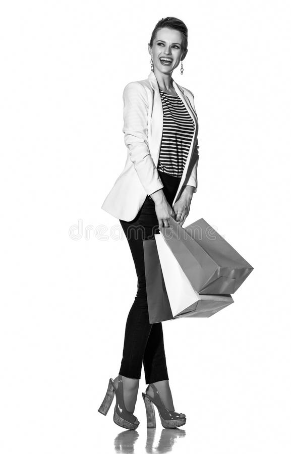 Excited young woman with shopping bags looking on copy space royalty free stock image