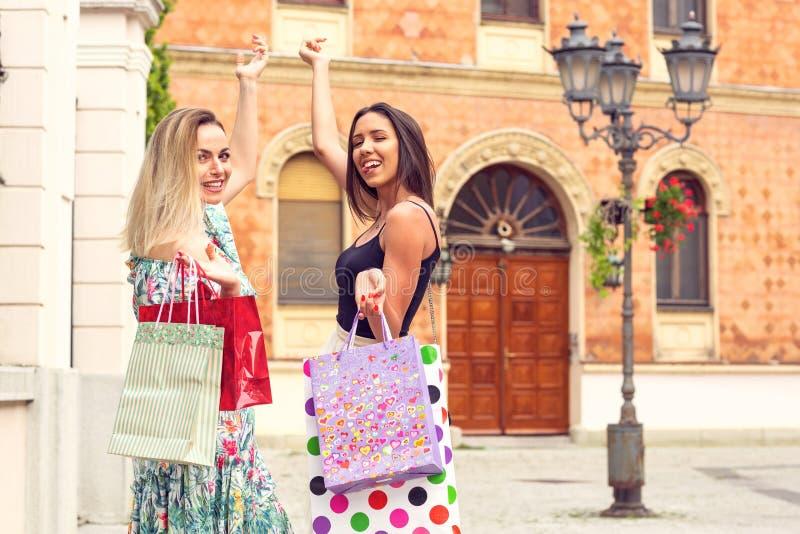 Shopping fun. bags, walking, holidays - Happy girls shopping. royalty free stock images