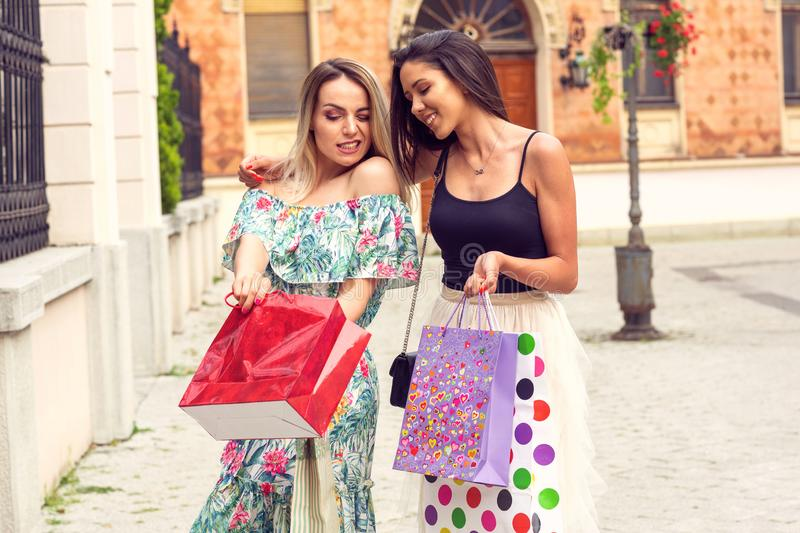 Shopping fun. - girls with shopping bags in the city stock image