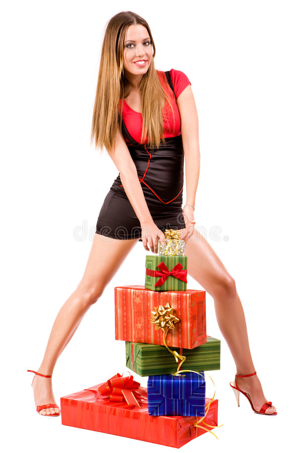Shopping girl. Beautiful shopping girl with colorful gift boxes stock image