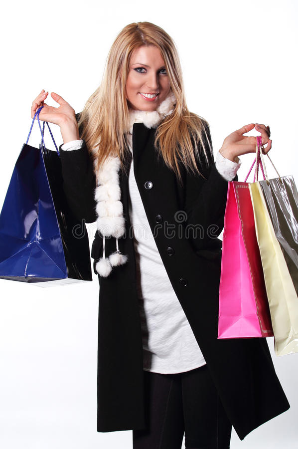 Shopping girl carrying bags royalty free stock image