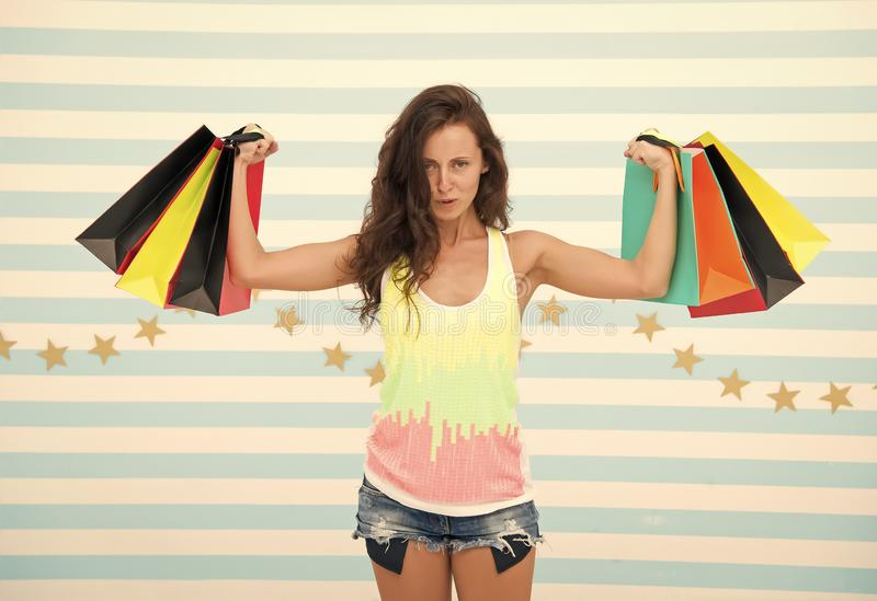 Shopping girl with heavy bags. after day shopping. muscular girl hold purchase or present packages. strong shopaholic royalty free stock image