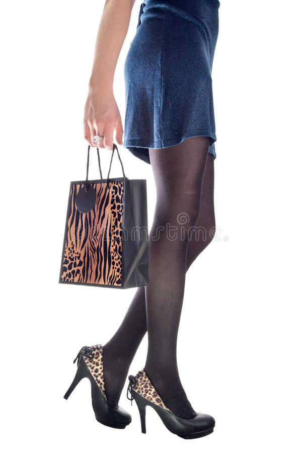Shopping girl legs royalty free stock photography