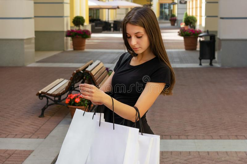 Shopping girl looking in bag sale lifestyles happiness royalty free stock images