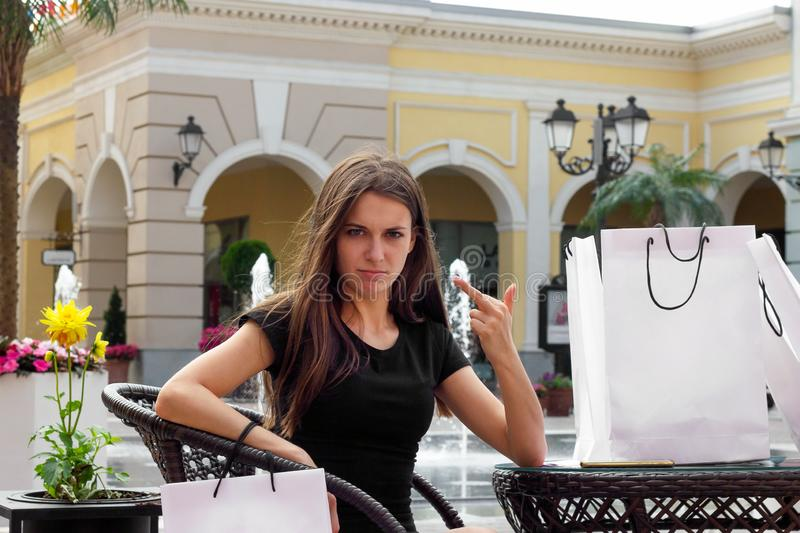 Shopping girl shows finger shopper lady choice bad royalty free stock images
