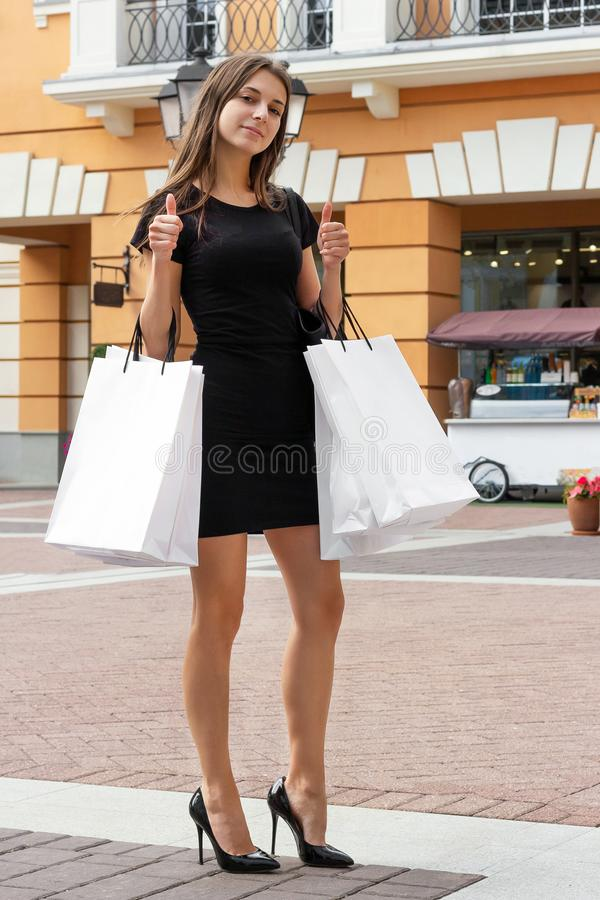 Shopping girl shows like shopper lady choice smile stock images