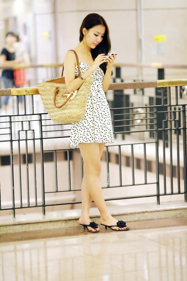 Shopping girl texting royalty free stock photo