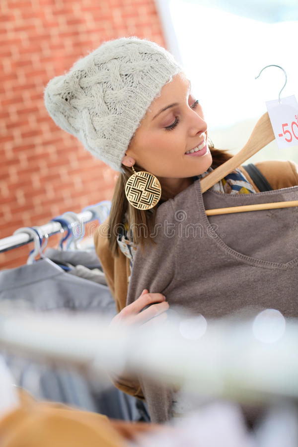 Shopping girl during winter sales royalty free stock photography