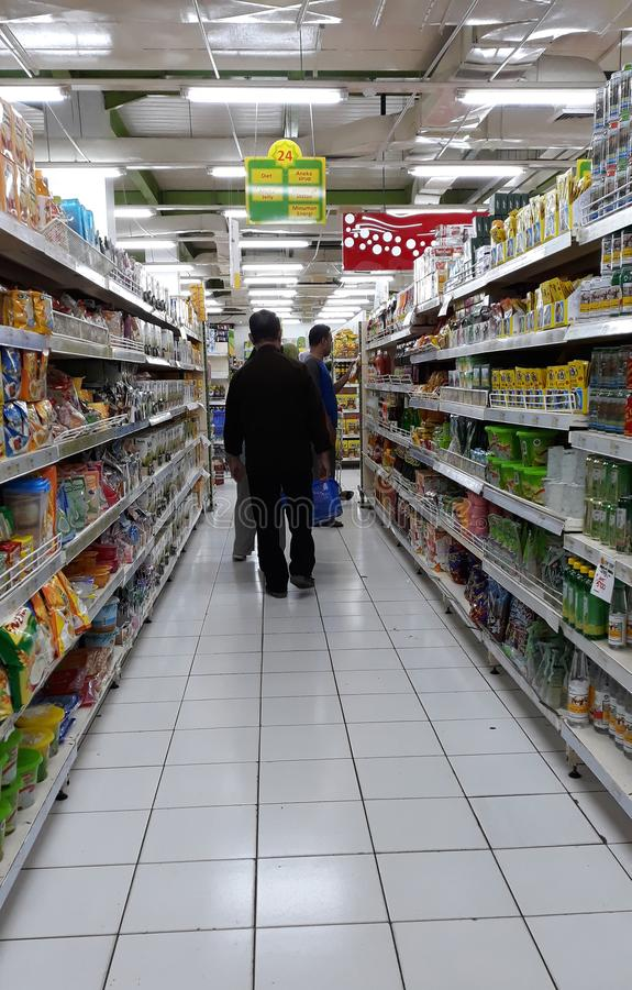 Shopping at grocery. Depok, Indonesia - January 1, 2019: People are shopping at grocery stores in Margo City Mall royalty free stock images