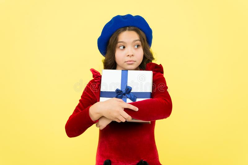 After shopping. happy birthday. boxing day. parisian girl in french beret go shopping. autumn fashion. school fall. Season. greedy small girl with present box stock photography