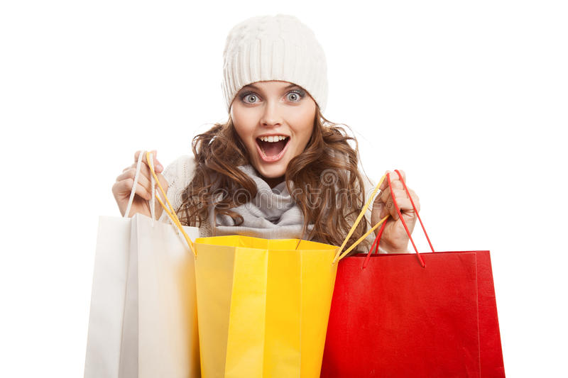 Shopping happy woman holding bags. Winter sales. Isolated stock photos
