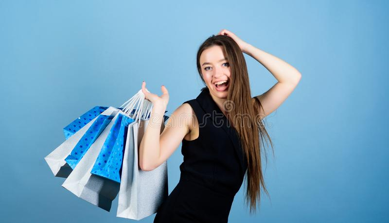 Shopping is her passion. Beautiful woman with shopping bags smile happy face. Mid season sale. Girl hold bunch packages royalty free stock photography