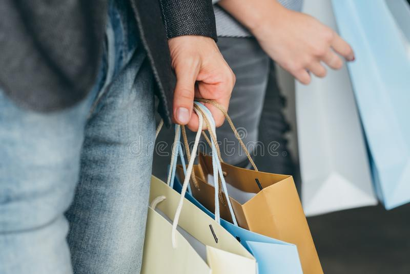 Shopping holiday season sale man bags hand royalty free stock photography