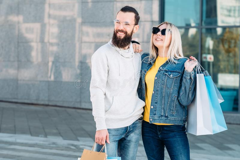 Shopping joy sale consumerism young couple bags royalty free stock image